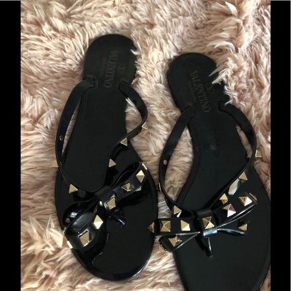 dc4d2817306332 Black Valentino Garavani Rockstud Jelly. M 5b8ff69b5fef37767fbb7733. Other  Shoes you may like. Valentino Rock-stud Flat Thong Sandals ...